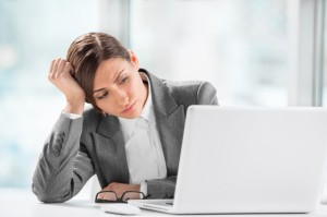 Portrait of beautiful executive working on computer at office